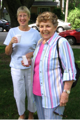 Irene Critchlow & Betty Godin sample the juice