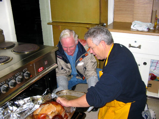 Turkey Grower & Chef Raymond Golden gets some help from Bill Lynn