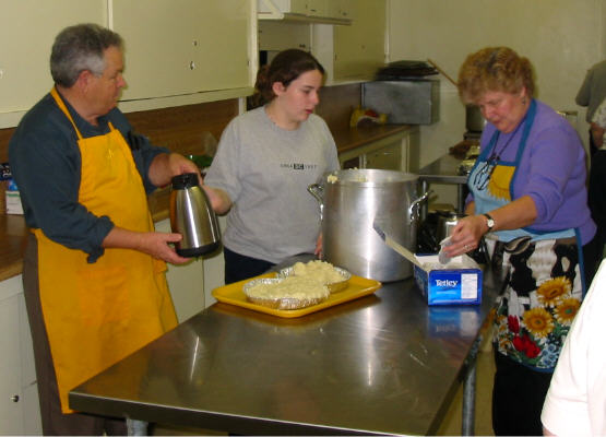 Raymond Golden, Jennifer Worsnip and Marion Golden in the kitchen.