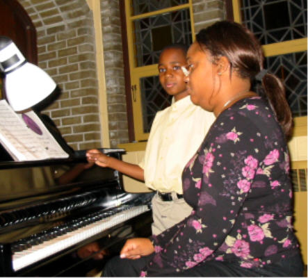 Accompanist Lucia Williams (St. Andrew's Organist & Choir Director) & her page turner Daniel.
